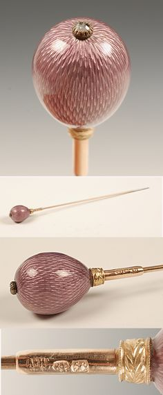Fabergé's hat pin. Made by workmaster August Hollming, around 1890. As you can see, Fabergé's famous eggs were used for many different things - even as hat pins. This 6'' (15.2 cm) long pin is made of gold, with it's egg-shaped head covered in translucent mauve enamel over a hatched surface. Around the base of the egg sits a chased leaf collar, and at it's top a diamond set terminal.