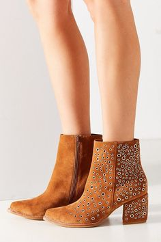Suede ankle bootie with metal eyelet detail. Jeffrey Campbell Bravado Eyelet Ankle Boot