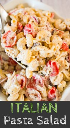 Italian Pasta Salad is a delicious cold side dish recipe perfect for potluck parties. This creamy pasta salad is loaded with cherry tomatoes red onions salami bacon basil pesto Parmesan cheese and mozzarella cheese. Creamy Pasta Salads, Pasta Salad Recipes, Recipe For Creamy Pasta Salad, Macaroni Salads, Italian Dishes, Italian Recipes, Pasta Dishes, Food Dishes, Side Dishes