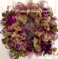 This gorgeous burlap colored deco mesh wreath is created with plum and sage green wired ribbon for easy reshaping, plum and lavender flowers, and a