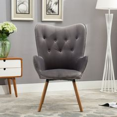 """With the silky velvet fabric, soft foam, solid wood legs, everything about this tufted button, barrel-backed chair cries """"well-crafted elegance"""". Perfect for a foyer, office or accent piece, you can offer this chair to your guests with confidence. Comfortable, yet formal, this chair offers a smooth look of comfort and professionalism."""
