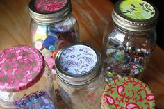 mod podge scrapbook paper to top of mason jar lid or regular screw top jar lid
