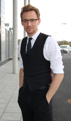 Tom Hiddleston wearing glasses. He looks even better in an everyday place. It makes him look real.