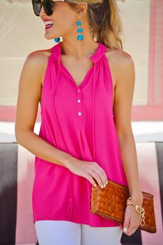 "$45.00 Embrace spring in our ""Teagan Tassel Tank""! An adorable pink tank is made cuter by tassel ties. Complete the look with our ""Teggy Earrings"" !"