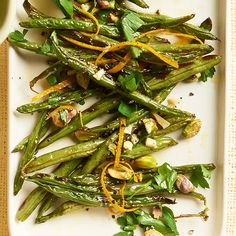 Roast your green beans in a super hot oven this Thanksgiving season -- the elevated temperature will leave them perfectly charred and smoky. Balance the depth of their flavor with a smattering of pistachios and fresh orange zest./