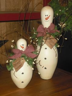 Bowling pin snowmen! Ask at your favorite bowling alley..They usually just throw them away. They may need filled in with filler. Paint white.. I use a sock and cut it for their hat. I put a little snow on the hat and a small flower or a bell on the tassel of his hat. I put a scarf on mine. Also put felt on the bottom so that he doesn't scratch your table.