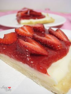 Strawberry Pizza Recipe ~ The pizza crust is a crisp, shortbread cookie. It is spread with a layer of sweetened cream cheese and a strawberry glaze and topped with sliced fresh strawberries. Perfect for Valentines Day!