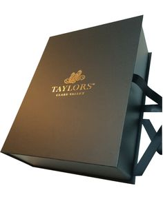 Luxury corporate gift box with gold foil logo print and silk satin ribbon closure