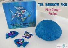The Rainbow Fish by Marcus Pfister Inspired Play Dough Recipe - a brilliant blue play dough matching the beautiful shades of blue in the story and silver glitter to represent the silver sparkle scales.