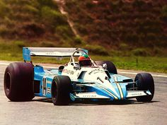 1977 Brazilian GP at Interlagos Larry Perkins with BRM P207 V12. The last designed F1 car by Len Terry, bulky‥it showed no signs of becoming competitive. Perkins qualified it for two GP starts, and only participant in this race. retired by lost water only first lap.