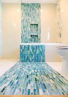 in a contemporary bathroom. A design and build firm in Los Angeles interior design contractor Glass Tile Bathroom, Bathroom Colors, Home Design, Interior Design, Large Bathrooms, Amazing Bathrooms, Luxurious Bathrooms, Blue Accent Walls, Simple Bathroom