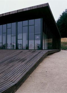 Modern Wooden House Designed Around a Deck | DigsDigs