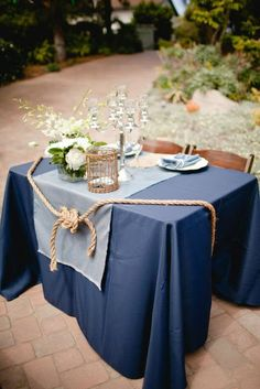 Love the knot decorating the sweetheart table. But only if we go rustic.