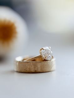 If you're looking for rings for both you and your partner, you've come to the right place! We'll help you find rings that fit both of your personalities and style. Here we have our Maggie Setting (seen on Kristin Johns) and her husband Marcus' ring!