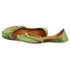 Featuring a lovely green colored women Punjabi leather jutti with golden work over it. This beautiful combination of green and gold makes you look like a diva!