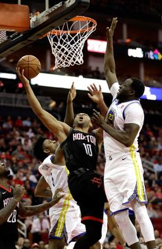 Houston Rockets' Eric Gordon (10) goes up for a shot as Golden State Warriors' Draymond Green (23) defends during the second half of an NBA basketball game Thursday, Jan. 4, 2018, in Houston. The Warriors won 124-114.(AP Photo/David J. Phillip)