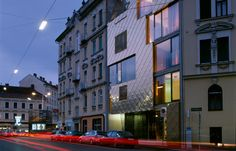 Golden Nugget by INNOCAD in Graz, Austria. The site is only 50m away from the historic centre of Graz, a UNESCO World Heritage Site. The architects managed to convince the planning authorities that the colour and form of the Golden Nugget complements the Wilhelmian style of the surrounding buildings. The buildin acts as a catalyst for the development of the area.