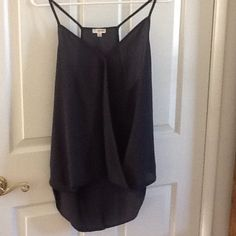 Flowing High Low Spaghetti Strap Flowing high low spaghetti strap camisole. Never worn, brand new. 100% Polyester. Lily White Tops Camisoles