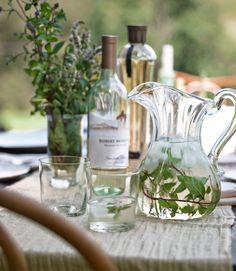 Greenery in the water jugs? White wine, lavendar, etc. So lovely.