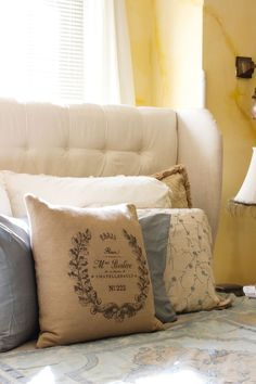 The Master bedroom is our retreat. It is now decorated in soothing colors for winter to include LOTS of pillows