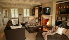 Cafe latte walls with white trim and rich brown furniture in this super cozy living room. Looks like my kind of room! Brown And Cream Living Room, Cream Living Rooms, Living Tv, Cozy Living Rooms, New Living Room, Home And Living, Living Room Decor, Sala Chocolate, Chocolate Color