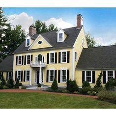 I think that yellow houses with white trim are so happy and inviting. LOVE the yellow and grey: Hawthorne Yellow Design Colonial House Exteriors, Colonial Exterior, Traditional Exterior, Yellow House Exterior, House Paint Exterior, Exterior Design, Exterior Colors, White Shutters, House Shutters