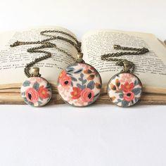 Les Fleurs Rosa floral fabric pendant necklace antique bronze coral peach…