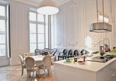 A dream kitchen if ever we saw one - dining/ kitchen/ french/ lighting/ high ceilings/ wall panels/ island/ cook