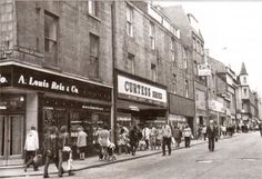 c1982- St Nicholas street looking North. The turreted corner building on the left of the picture is the first building on George Street and marks the  UpperKirkGate/Bon Accord Shopping Centre which opened in 1990.