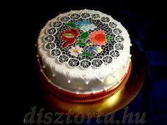 yes, that is a beautifully decorated cake with Hungarian motifs!