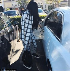 Black and white: The teenager wore a white and black coat and matching pants in an Instagram photo she posted on Sunday