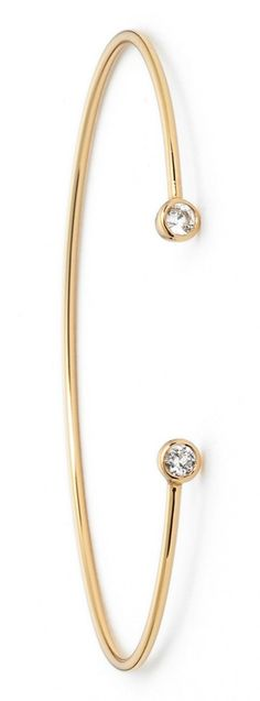 Crushing on this dainty gold cuff with white topaz stones. It will be perfect for stacking!