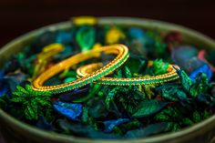 These beautiful green stones were hand picked to ignited your wrists full of life and the color of spring. 18k gold electroplated. Bangles come in pair. Available at http://www.gvccustomgold.com