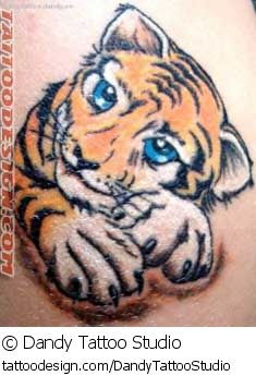 A tattoo design picture by Dandy Tattoo Studio: animal,tiger,cute,sexy,feminine,girly,girlie,female,woman,women,girl,lady,ladies,pretty,beautiful,small,little,simple,plain,tiny