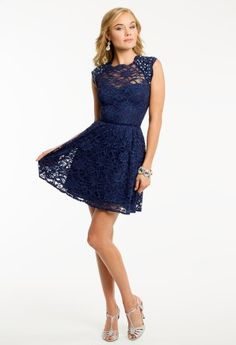 Lace party dress with iridescent beading and ribbon tie neck by Morgan&Company. • Lace bodice • Natural waist • Flair short skirt • Open back and center zipper