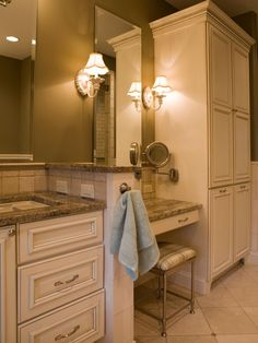 A custom-made armoire adds a warm, inviting feel to your bathroom while providing plenty of storage. This cottage-style armoire, designed by Shane Inman, coordinates with the custom vanity for a seamless look. Drawers underneath the sink provide additional storage.