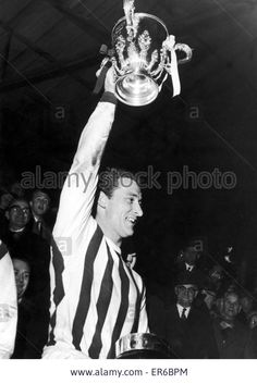 23rd March 1966. West Brom captain Graham Williams holds aloft the League Cup trophy following a 2nd Leg match at the Hawthorns in which the Baggies beat West Ham United 4-1.