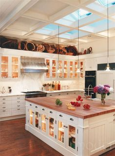 I think I'm in love with kitchen islands!! This is perfect! Beautiful and functional with wood counter and storage!!