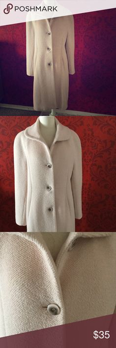 """Light pink beige long winter coat Beautiful winter coat. The color s a very light pinkish beige with light beige lining. Fabric is textured wool. Shape is a trending - a bit oversize.  Hangs nicely. There are some stains, very small tears, and small underarm seam tear on the inside lining but otherwise outside is in great condition. Measures 42"""" from shoulder seam at neck to hem. Searle Jackets & Coats"""