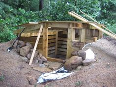 Amazing. It's a semi-underground coop inspired by bank houses & Anasazi pit houses. Another nice stealth coop idea! (Good luck explaining it to buyers when you move, though—root cellar?)
