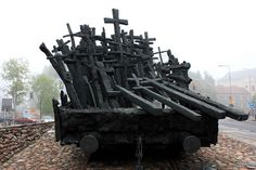 Monument to Those Killed and Murdered in the East, Warsaw Raised to honour the memory of Poles who were expelled to labour camps in Siberia and to the victims of the Katyn massacre. Revealed in 1995 on the 56th anniversary of the Soviet Union's attack on Poland. The monument presents a pile of crosses on an open rail car which sits on a set of tracks. Each rail tie features the name of a town which was a scene of crimes perpetrated against the Poles in the USSR.