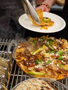 The chile con queso in these over-the-top nachos is totally addictive. Recipe from SF restaurant, Tacolicious.