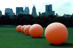 Art: Five Orange Balls  Location: Los Angeles, California  Artists: Stuart Williams    Description: This traveling installation spanned a time period of two and a half years, and included urban and rural sites across the U.S. and Europe creating odd scenes of giant balls completely out of context making people take notice of their environment and to be filled with a sense of wonderment.