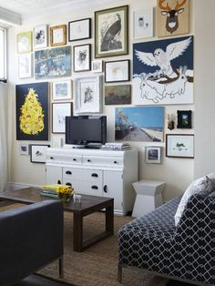 sometimes i think about hanging all our art behind our tv so the tv wouldn't stand out as much
