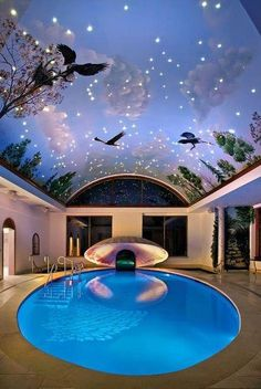 How lovely! You could reproduce this with a ceiling mural, some nice strip lighting and one of our fiber optic star kits.
