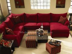 Diggin' the red sectional and the coffee table with the pull-out ottomans! Fletcher Red Sectional Sofa