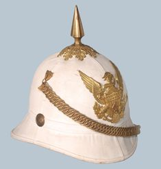 "An example of the helmet, which seems to have been ""painted"" with Blanco to give it a fresh white look. This helmet features the brass hardware, including spike… American War, American Soldiers, Military Surplus, Military Uniforms, Small Castles, Military Equipment, Military History, Summer Sun, Us Army"