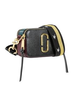 MARC JACOBS Snapshot Small Camera Bag- BlackSize & Fit Dimensions: Height:12cmx Width: 19 cm x Depth: 6 cmStrap drop: 60 cmDetails Snapshot Small Camera Bagby Marc JacobsBlackThis mini bag will hold just your essentials - phone, cash, keys and a bit of makeupCamera-style bag withtri -colour Saffianoleather panels - front and back are black, while the sides areteal and burgundyThick detachable fabric strap with a gold metallic stripe and silver star design and lobster clasp fastening...