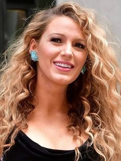 Blake Lively got a dramatic corkscrew-curl perm that is VERY different from her typical hairstyle.