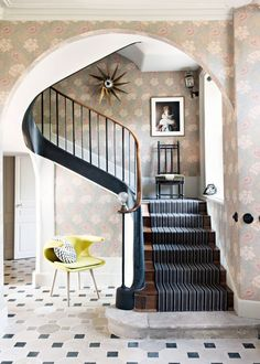Bold large-scale floral wallpaper in the stairwall